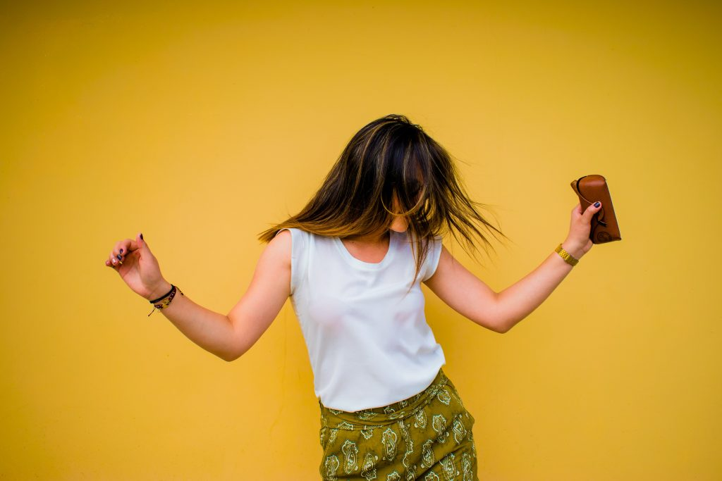 dancing girl against yellow background
