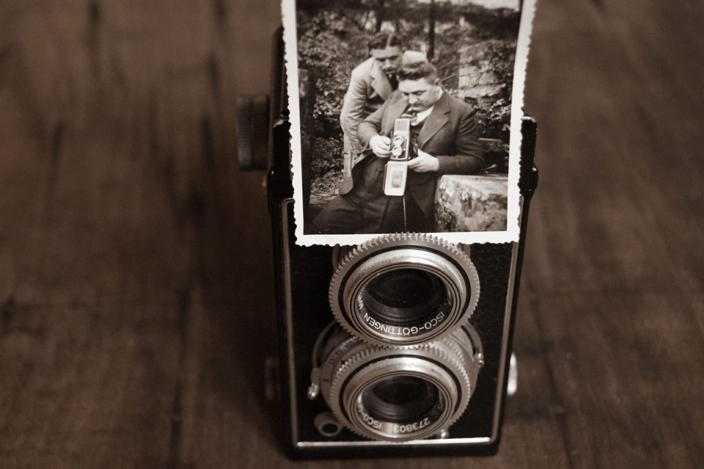 vintage camera and old family photo